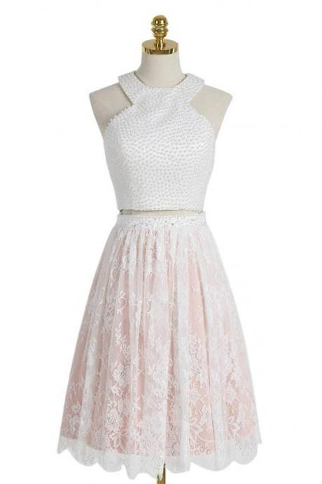 Two-Piece Homecoming Dress Featuring Knee-Length Lace Skirt and Cropped Beaded Halter Neck Bodice